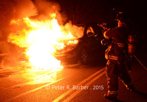 Schenectady firefighter firefighter/paramedic Scott Briggs battles a car fire on Roasa Road at Nott Street Thursday, November 26, 2015.
